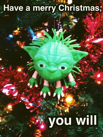 Photo of Yoda hanging on tree. Have a merry Christmas, you will.