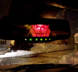 Brake lights making sled in bed of truck glow red