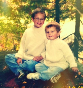 Young boys in matching cream sweaters