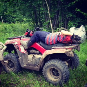 SK stretched out on his four wheeler staring at the sky