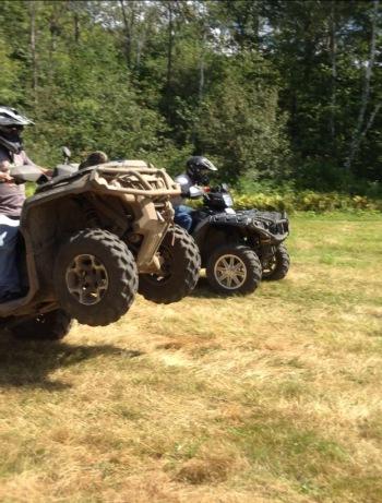 Doing a wheelie on his ATV