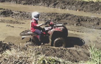 Short Kid's ATV stuck in the mud pit