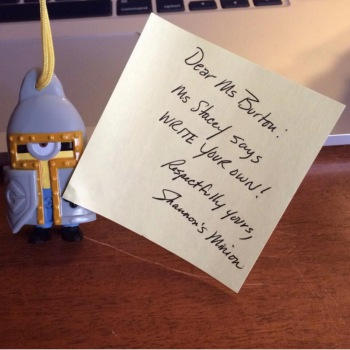 Minion in medieval armor holding sticky note