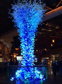 Sculpture made of LED tubes that shift color and rise up like a water geyser