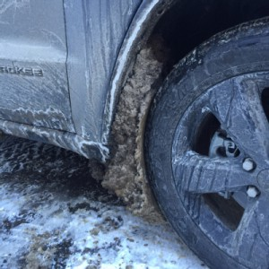 Salt and slush build up in Jeep's wheel well