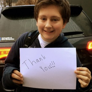 Cute kid holding a thank you sign