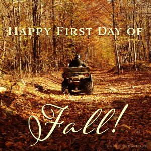 A photo of my husband riding his ATV through fall foliage with the caption: Happy first day of fall